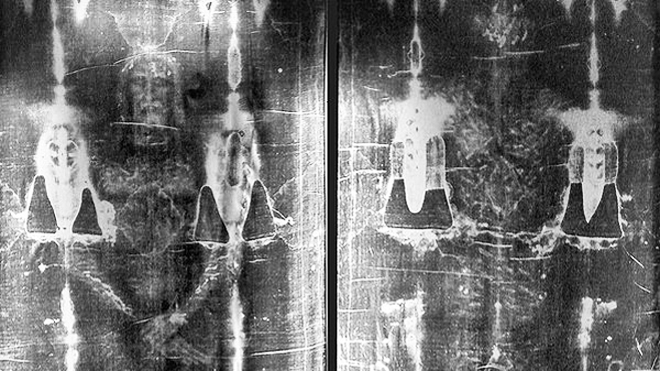Full-length negative photograph of the Shroud of Turin.
