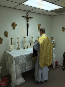 Fr. Nix Offering Mass